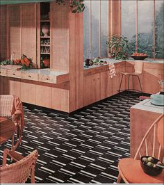 1956 Armstrong Kitchen. I like the sliding screens in front of shelving/storage.