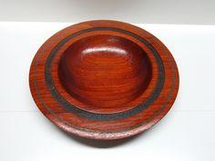 Handmade woodturning. Padauk wood bowl with chrysocolla inlay and india ink detail.