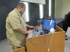 This year's IT Showcase ( #ITSC ) Lunch was presented to Industry and #HSCC students participating in National BDPA's annual Regional #TECH Summit and 2015 #APBI (Advance Program Briefing to Industry.) Above, Michael Bijou prepares his demonstration. His topic was: Self-Contained Advanced Raspberry Pi Media Center. Photo by Catherine Williamson: bdpatoday © 2014