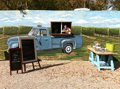 cool mural with window. This is a lunch truck.
