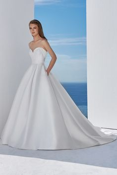 This Mikado ball gown with a sweetheart neckline is the perfect classic look with modern style details. Featuring a back cuff and illusion beading that your guests are sure to remember.
