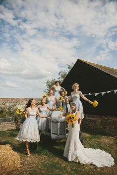 Chi Chi London Bridesmaid Dresses | Outdoor Ceremony at Elmley Nature Reserve | Rustic Barn Reception | Sunflower Bouquet | McKinley Rodgers Photography | http://www.rockmywedding.co.uk/bex-drew/