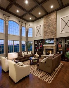 Contemporary Living Room with Box ceiling Hardwood floors High ceiling Arched window stone fireplace Built-in bookshelf Room Arrangement Ideas, Living Room Arrangements, Living Room Furniture Arrangement, Home Living Room, Living Room Designs, Living Room Decor, High Ceiling Living Room, Living Area, Family Room Design