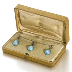 A FABERGÉ DIAMOND, PLATINUM AND ENAMEL NECKLACE, MOSCOW, CIRCA 1895.  the chain of elongated oval links, suspending three rose-cut diamond-set laurel wreaths above pendant eggs enamelled in translucent pale turquoise over hatched surfaces, apparently unmarked, in original wood case,  length of chain 38cm, 15in.