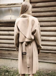 A trench coat is the perfect cover up for commute to desk.