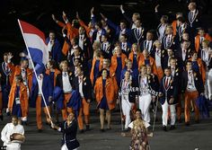 The Dutch squad were as colourful as always in their orange and blue jackets. Dorian van Rijsselberghe, a windsurfer, enthusiastically waved the flag