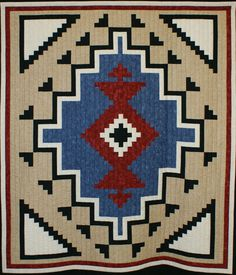 """601-MyNavajoRug.jpg - 601Valerie Maier - My Navajo Rug -- Pieced Quilt, small - 1 person. Exhibit Only. 54x64"""". 2003. Machine quilted by Valerie Maier. Two Gray Hills by J. Michelle Watts."""