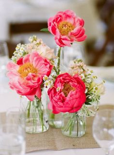 Photographer: Josh Gruetzmacher; Wedding reception centerpiece idea