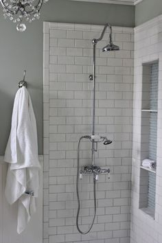 DIY tall shower niche tutorial with exposed shower, mosaic glass and white…