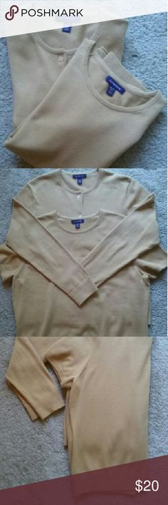 Land's End  ladies sweater set This tan set consists of  (1) long sleeve cardigan which has all of its buttons+1 extra, and (1)matching short sleeve shell. It features ribbing at the bottom of each sweater, sleeve and at the neckline. FYI: very good condition, no pilling or stains. Lands' End Sweaters Cardigans