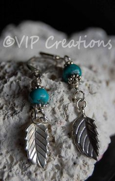 Love these earrings, authentic turquoise bead & classy sterling leaf charm on sterling silver leverbacks, lovely summer jewelry. www.vipcreations.etsy.com