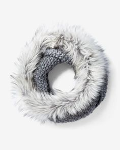 Sumptuously soft faux fur and rich knitting combine to keep you luxuriously warm and toasty. Pair it with your favorite top and dress pants for a glam cold-weather look.
