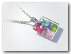 The pendant measures :  20mm x 20mm x 20mm 18 inch silver plated chain with a lobster clasp.