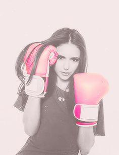 Nina Dobrev with boxing gloves on