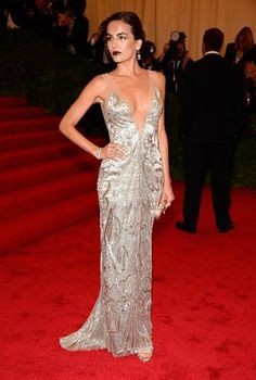 The actress looked sultry and sexy in this V-cut silver lamé gown.