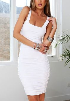 This white ruched tank dress features ruched detailing at both sides, square neckline and sleeveless cut.   Lookbook Store