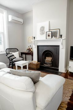 Black and white fireplace done right + unconventional bar station + jute rug
