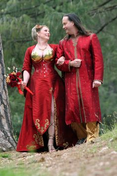 GORGEOUS red wedding dress ... and love the groom's coordinating red jacket!