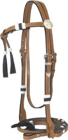 "Cowboy Pro Horsehair Hitched Bridle - Pecan - Horse by Action. $48.20. Color: Pecan. Size: Horse. Constructed Of 5/8"" Wide Double Ply Strap, Hand Braided Horsehair Knots And Tassels With Quick Change Loop And concho Bit Hangers."