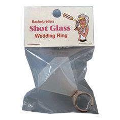 """Bachelorette's Shot Glass Wedding Ring    She's not getting married yet. Have the bachelorette take off her sparkling princess-cut gem and wear the Shot Glass Wedding Ring to her party. The """"diamond"""" opens up, so it can be filled with the bride-to-be's favorite liquor. She can wear it around the bar and demand others to fill it up for her."""