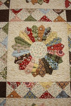AmericanQuilting: Our upcoming retreat!------I love the quilting on this dresden plate