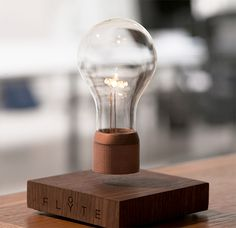 #Flyte Levitating Light - Magnets are what makes the Flyte light levitate. It requires no batteries; instead it is powered by induction. The design features an Edison-style bulb using bright, energy efficient LEDs, and a wooden base made of sustainably-sourced oak, ash, or walnut.