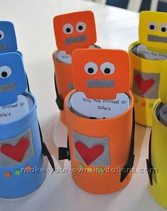 tutorial: make your own robot party invitations.  Another idea would be to adapt this idea to be stubby holders for drinks at the party.