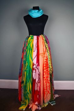 """Try a more creative approach with the """"scarf skirt."""" Customers will do a double take at this beautiful skirt created using printed scarves tied to a belt."""