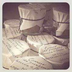 Candles wrapped in paper with script and then sealed