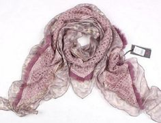 A beautiful Chinese lace bandage scarf with sparkling sequins. This lace bandage scarf comes in four great colours, coffee, light grey, lilac or pink. A perfect addition to your collection.