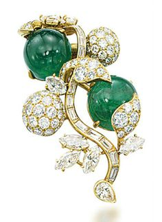 AN EMERALD AND DIAMOND BROOCH, MOUNTED BY CARTIER.  Designed as a spray of stylized flowers, with baguette-cut diamond stem, marquise-cut and pavé-set diamond leaves and flowers, to the two cabochon emerald accents, 4.8 cm, with French assay mark for gold