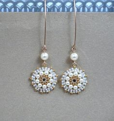 SALE 10% OFF with coupon code: 10DISCOUNT I created this earrings by hand, using Swarovski 3mm and 5mm pearls, Miyuki round seed beads, Miyuki Delica beads and goldfilled 14k ear-wire * Measurements: Earring length: 2.36 (6cm) Pendant diameter: 0.59 (1.5cm) * The earrings will come beautifully packaged for gift. *Additional information on the matching necklace you can see here: https://www.etsy.com/listing/218361968/pearl-pendant-necklace-pearl-bridal?ref=shop...