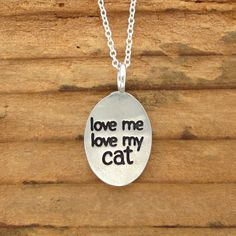 Super fun reversible necklace with a happy cat on the front and the words love me love my cat on the back. Perfect for cat lovers. This hand cast pewter pendant is about an inch tall. It hangs from a silver plated chain with a spring ring clasp. You now have the option to choose between 16, 18, and 20 inch chains. Items are shipped without a receipt in a gift box. If youd like to include a gift message, please let me know. See my policies for more information on shipping: https:/&#x2F...