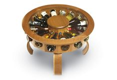 The Don Vino wine table is an original design, inspired by the oak barrels that line the cellars of the Finger Lakes regional wineries. It not only offers contemporary styling but also a tasteful showcase for your wine collection. The wine table pictured here stands 21 inches