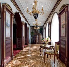 Inside a Russian mansion. Inside Drew Lukhov's house where Adam Lukhov waits to go inside of his father's office?