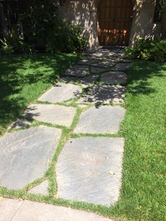 gray irregular flagstones with grass between