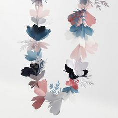 Make this beautiful flower garland with punched-out card and vellum paper flowers and twigs. The flowers are folded and threaded onto cotton cord. The twigs are glued onto the cord. Vellum Paper, Paper Art, Paper Crafts, Diy Crafts, Easy Pumpkin Carving, Diy Halloween, Bracelet Making, Jewelry Making, Origami