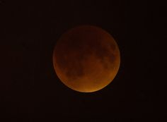 NASA photographer Aubrey Gemignani captured this amazing view of the perigee moon total lunar eclipse over Washington, D.C. on Sept. 27, 2015.