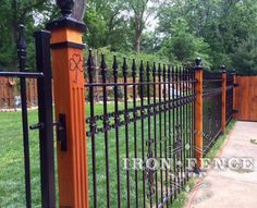 Using Wood Posts with Wrought Iron Fence for a Custom Look | Iron ...