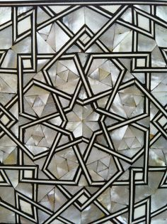Close view of the Moorish coffee table inlaid ivory detail in The Hall at Standen, West Sussex