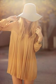 Floppy Hat and Pleats.