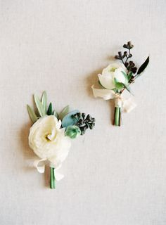 simple pretty white and green boutonnieres