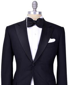 Kiton Black Tuxedo Single button tuxedo Peak lapel Grosgrain lapel Black melton Black lining Flap pockets Double vent Flat pant with grosgrain side seam stripe 100% wool, 14 micron Handmade in Italy