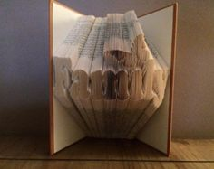 "Book folding pattern for ""Family with a butterfly over the i"" +FREE TUTORIAL"
