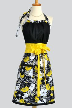 Cheerful Kitsch Retro Apron would make me a happy cook ;)  I'd like to find the same fabric and make a cover for my KitchenAid Mixer