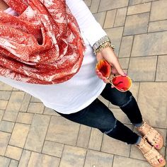 IG @mrscasual <click through to shop this look> sole society pineapple infinity scarf. White Jcrew tee. Nordstrom destroyed skinny jeans. Jeweled sandals. Red and gold rayban aviators.