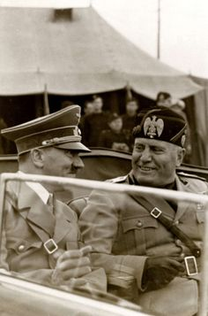 """The two dictators during Hitler's visit to Italy in May 1938. This is one of the rare occasions Mussolini was caught by the camera wearing a broad smile. The Italian spoke German so communication between the two was comfortable. Hitler admired Mussolini as a man """"of action."""" In the end, neither of them escaped the fate produced by both of their actions."""