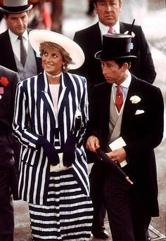 The Prince and Princess of Wales at a Royal Ascot meeting June 1987 Diana wears a striped suit by Roland Klein and hat by Philip Somerville