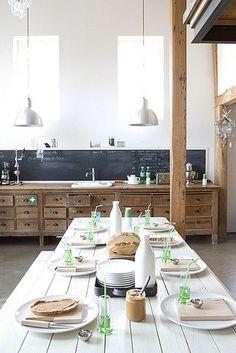 natural wood cabinets and chalkboard backsplash