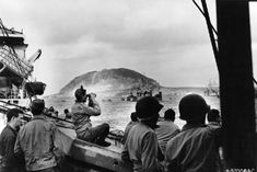 U.S. soldiers inspect the coast of Iwo Jima before landing from ships.